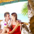 Portrait of attractive couple having date on the beach — Stock Photo #25994773