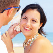 A portrait of attractive couple having fun on the beach — Stock Photo #25996407