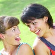 Stock Photo: Portrait of two young woman having fun in summer environment