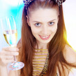 High-key portrait of young woman with glass of champagne in multicolor back lights. Image may contain slight multicolor aberration as a part of design — Stock Photo