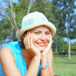 Portrait of young beautiful woman in colorful hat in summer environment — Stock Photo #26004483