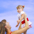 Portrait of young happy mother holding her baby — Stock Photo