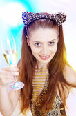 High-key portrait of young woman with glass of champagne in multicolor back lights. Image may contain slight multicolor aberration as a part of design — Stok fotoğraf