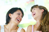 Portrait of two young woman having fun in summer environment — Stok fotoğraf