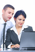 Portrait of two young businessman in working environment — Stock Photo