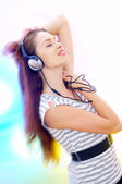 View of young female listening music via earphones. Image may contain slight multicolor aberration as a part of design. — Stock Photo