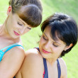 Portrait of two young woman having fun in summer environment — ストック写真