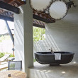 Stok fotoğraf: View of summerhouse terrace with black bath in middle