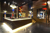 Panoramic view of nice stylish reception desk during nighttime — Stock Photo