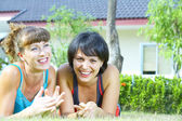 Portrait of two young woman having fun in summer environment — Stock Photo
