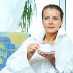 High key portrait of nice gorgeous woman drinking coffee — Stock Photo