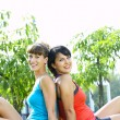 Portrait of two young woman having fun in summer environment — Stock Photo #26044827