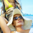 View of female in sailor-hat on a background of the tropical sea — Stock Photo