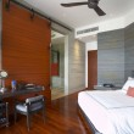 Panoramic view of nice light stylish hotel room. — Stock Photo #26045889