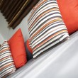 Fragment like view of nice stylish pillows upon sofa — Stock Photo