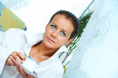 High key portrait of nice gorgeous woman drinking coffee — Stock Photo
