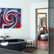 Stok fotoğraf: View of nice stylish bathroom. Image on wall was contorted!