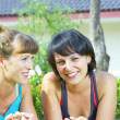 Portrait of two young woman having fun in summer environment — Foto de Stock