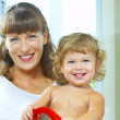 High key portrait of happy mother with baby — Stock Photo
