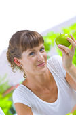 High key portrait of young woman with apple — Stock Photo