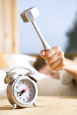 Close up view of big kitchen hammer is ready to crash alarm-clock — Stock Photo