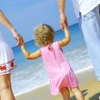 View of young family spending time on the beach — Stock Photo