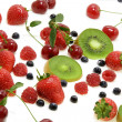 View of different kinds of berries on milky background — Stock Photo