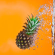 View of nice big pineapple getting through the water — Stock Photo
