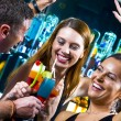 Motioned portrait of young attractive having fun in night club — Stock Photo