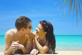 A portrait of attractive couple having date on the beach — Stock Photo