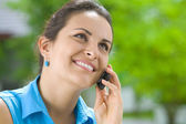 Portrait of young beautiful woman with mobile phone — Stock Photo