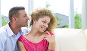 Portrait of young attractive happy couple in domestic environment — Stockfoto