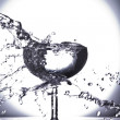 Close up view of margaritglass getting splashed on gray back — Stock Photo #26143703