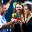 Motioned portrait of young attractive having fun in night club — Stock Photo #26145977