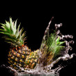View of two nice fresh pineapples on black background — Stock Photo #26146495