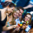 Portrait of young attractive having fun in night club — Stockfoto #26146943