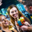 Motioned portrait of young attractive having fun in night club — Stock Photo #26157127