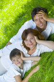 Portrait of young happy family in summer environment — Stock Photo