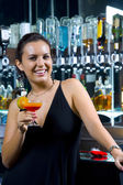 Portrait of young attractive woman having good time in bar — Stockfoto