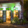 Stock Photo: Panoramic view of small tropic Chinese restaurant entrance