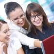 Portrait of young pretty women discussing project in office environment — Foto Stock