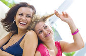 Portrait of two young attractive girls having good time — Photo