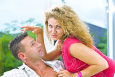 Portrait of young attractive happy couple in domestic environment — Stock Photo