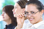 Portrait of young pretty woman in business environment — Stock Photo