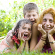 Portrait of little kids with mama having good time in summer environment — Stock Photo