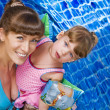 Portrait of young attractive woman having good time with her daughter — Stock Photo