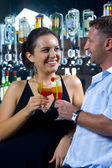 Portrait of young attractive couple having date in bar — Stock Photo