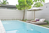 Panoramic view of nice luxury tropical patio with pool in it — Stock Photo