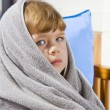 Portrait of beautiful little blue eyed girl wrapped in towel — Stockfoto