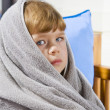 Stock Photo: Portrait of beautiful little blue eyed girl wrapped in towel